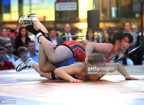Helen Maroulis of the United States and Yuzuru Kumano from Japan compete in the Womens freestyle 58 kg/128 lbs match during the Beat The Streets...