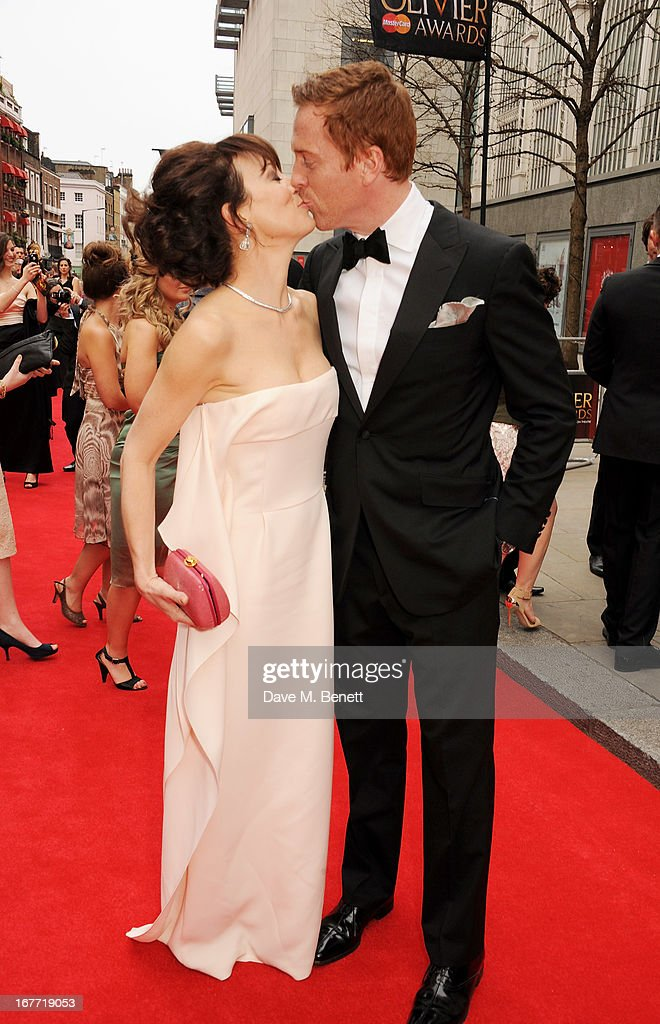 <a gi-track='captionPersonalityLinkClicked' href=/galleries/search?phrase=Helen+McCrory&family=editorial&specificpeople=214616 ng-click='$event.stopPropagation()'>Helen McCrory</a> (L) and <a gi-track='captionPersonalityLinkClicked' href=/galleries/search?phrase=Damian+Lewis&family=editorial&specificpeople=206939 ng-click='$event.stopPropagation()'>Damian Lewis</a> arrive at The Laurence Olivier Awards 2013 at The Royal Opera House on April 28, 2013 in London, England.