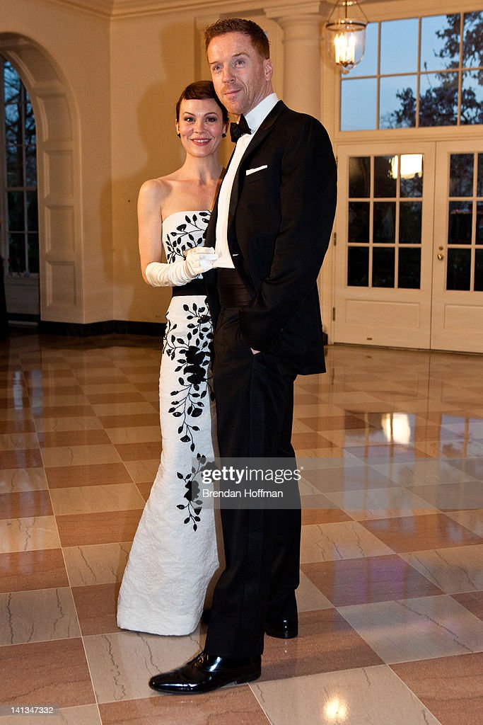 <a gi-track='captionPersonalityLinkClicked' href=/galleries/search?phrase=Helen+McCrory&family=editorial&specificpeople=214616 ng-click='$event.stopPropagation()'>Helen McCrory</a> and <a gi-track='captionPersonalityLinkClicked' href=/galleries/search?phrase=Damian+Lewis&family=editorial&specificpeople=206939 ng-click='$event.stopPropagation()'>Damian Lewis</a> (R) arrive for a State Dinner in honor of British Prime Minister David Cameron at the White House on March 14, 2012 in Washington, DC. Cameron is on a three day official visit to Washington.