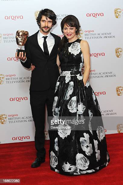 Helen McCrory poses with Ben Whishaw after presenting him with the Best Actor Award in front of the winners boards at the BAFTA TV Awards 2013 at The...