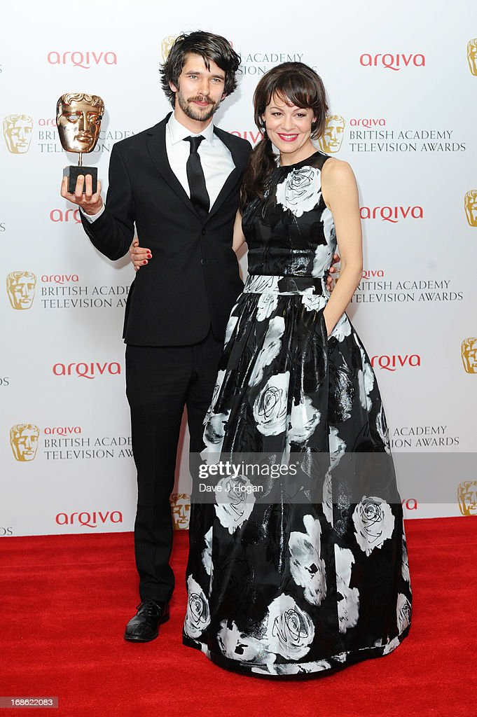Helen McCrory poses with Ben Whishaw after presenting him with the Best Actor Award in front of the winners boards at the BAFTA TV Awards 2013 at The Royal Festival Hall on May 12, 2013 in London, England.