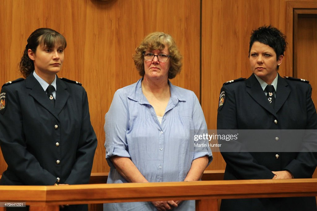 Helen Milner (C) arrives in court on February 20, 2014 in Christchurch, New Zealand. In 2013, Helen Milner was found guilty of the murder and attempted murder of her husband, Philip Nisbet, who was found dead in their Halswell home on May 4, 2009.