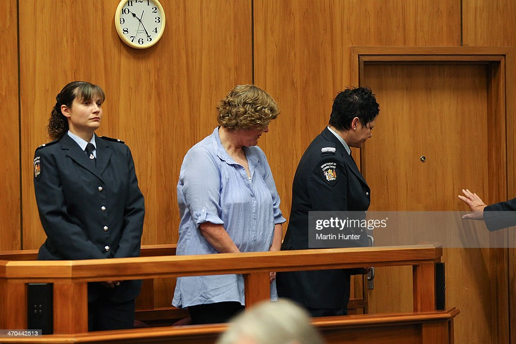 Helen Milner (C) leaves court after being sentenced on February 20, 2014 in Christchurch, New Zealand. In 2013, Helen Milner was found guilty of the murder and attempted murder of her husband, Philip Nisbet, who was found dead in their Halswell home on May 4, 2009.