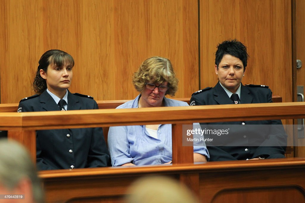 Helen Milner (C) sits in court on February 20, 2014 in Christchurch, New Zealand. In 2013, Helen Milner was found guilty of the murder and attempted murder of her husband, Philip Nisbet, who was found dead in their Halswell home on May 4, 2009.