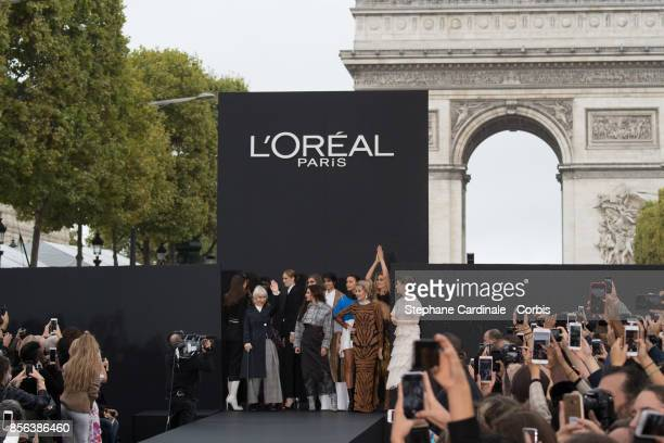 Helen Mirren Cheryl Cole Neelam Gill Irina Shayk Jane Fonda Doutzen Kroes and Barbara Palvin are seen on the runway during the Le Defile L'Oreal...