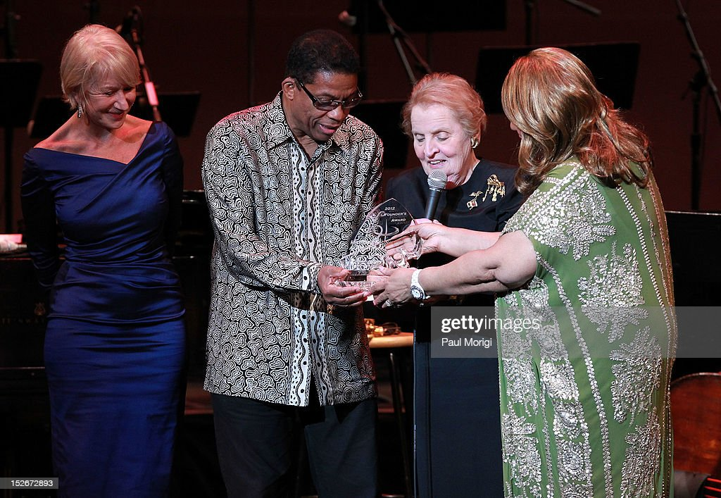 Helen Mirren, Herbie Hancock and Aretha Franklin present former U.S. Secretary of State Madeleine Albright (C) with the Maria Fisher Founder's Award at the Thelonious Monk International Jazz Drums Competition and Gala Concert at The Kennedy Center on September 23, 2012 in Washington, DC.