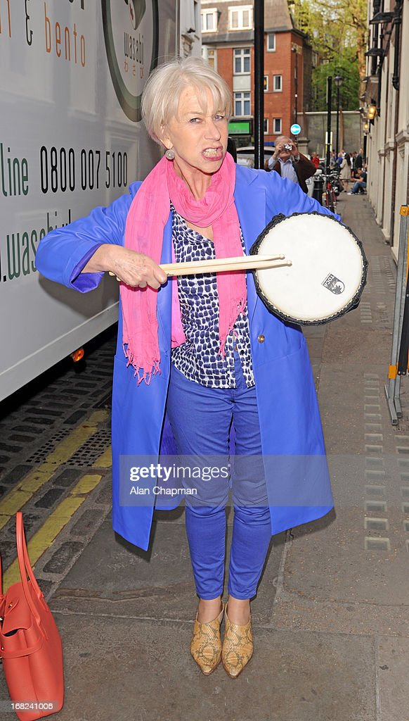 <a gi-track='captionPersonalityLinkClicked' href=/galleries/search?phrase=Helen+Mirren&family=editorial&specificpeople=201576 ng-click='$event.stopPropagation()'>Helen Mirren</a> is presented with flowers, a drum and an invitation to the 'As One In The Park' festival as an apology for the disruption to her stage performance on May 7, 2013 in London, England.