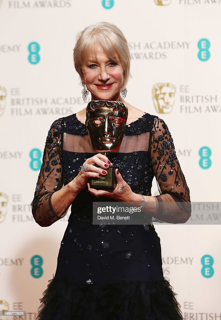 <a gi-track='captionPersonalityLinkClicked' href=/galleries/search?phrase=Helen+Mirren&family=editorial&specificpeople=201576 ng-click='$event.stopPropagation()'>Helen Mirren</a> poses with her BAFTA Fellowship award in the winners room at the EE British Academy Film Awards 2014 at The Royal Opera House on February 16, 2014 in London, England.