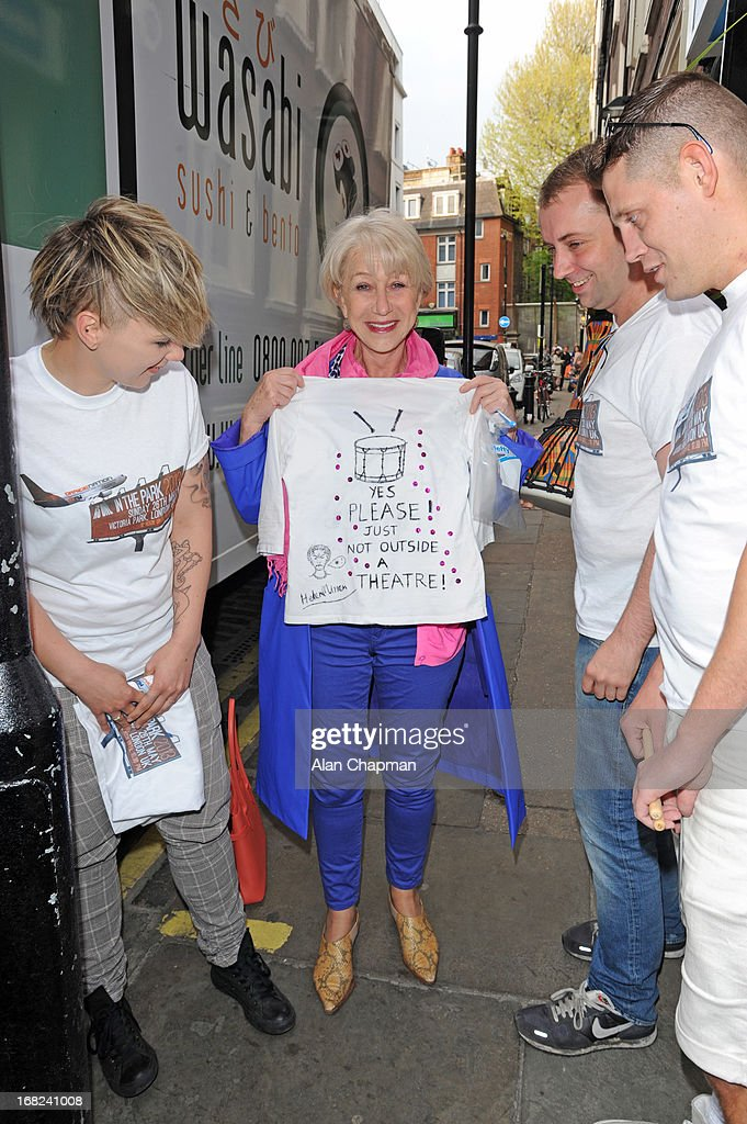 <a gi-track='captionPersonalityLinkClicked' href=/galleries/search?phrase=Helen+Mirren&family=editorial&specificpeople=201576 ng-click='$event.stopPropagation()'>Helen Mirren</a> presents her T shirt to the 'As One Ine Park' festival team as they present her with flowers and a drum as an apology for the disruption to her stage performance on May 7, 2013 in London, England.