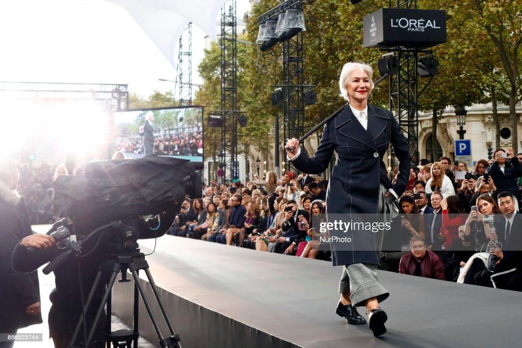 Helen Mirren walks the runway during the Le Defile L'Oreal Paris show as part of the Paris Fashion Week Womenswear Spring/Summer 2018 at the Champs Elysees Avenue in Paris, France, on October 1, 2017.