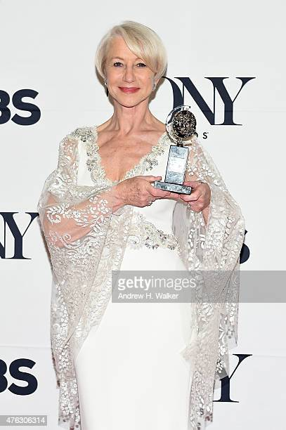 Helen Mirren winner of the award for Best Lead Actress in a Play for 'The Audience' poses in the press room during the 2015 Tony Awards at Radio City...