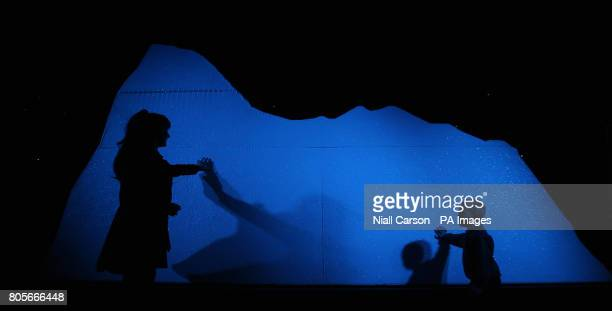 Helen O'Dwyer and 6 year old Jack Kelly from Lucan touch a mock iceberg at a preview of Titanic the Artifact exhibition which runs at the the...