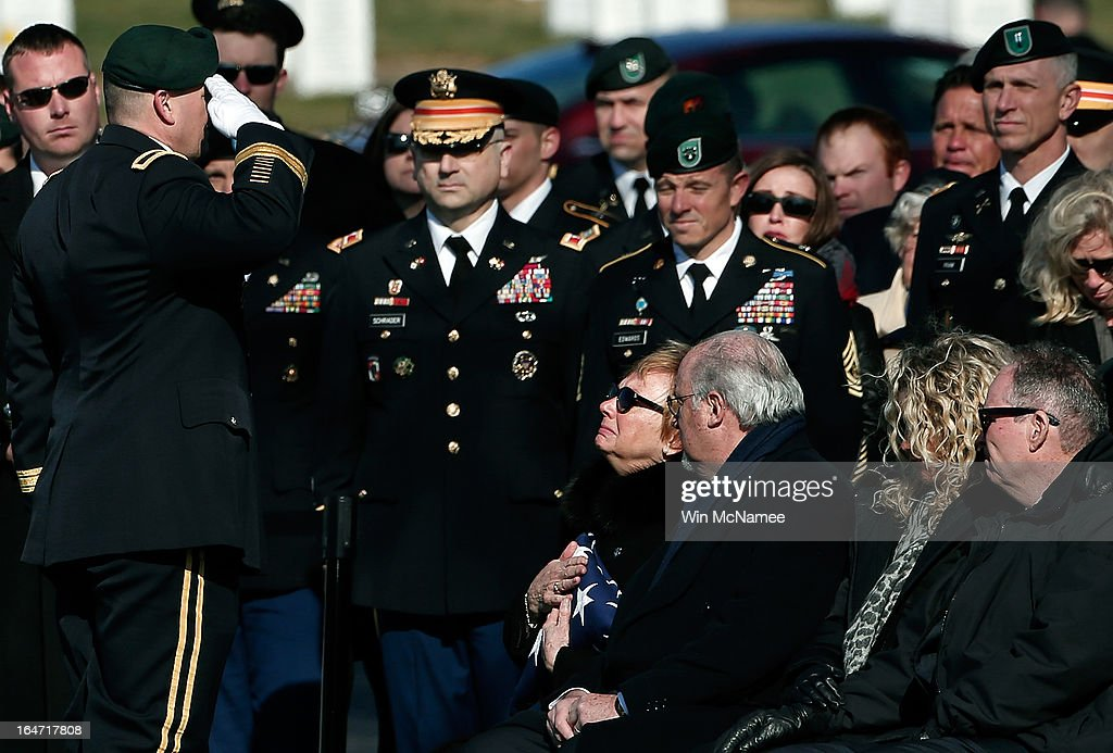 Helen Pedersen-Keiser clutches the American flag that covered her son's casket while saluted by Brig. Gen. Christopher K. Haas, commander, U.S. Special Forces Command, during a burial service for her son, U.S. Army Capt. Andrew Pedersen-Keel at Arlington National Cemetery March 27, 2013 in Arlington, Virginia. Capt. Pedersen-Keel was killed on March 11, 2013 while serving in Wardak Province, Afghanistan from injuries sustained when attacked by small arms fire from a man in an Afghan police uniform, according to reports.