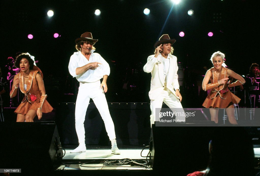 Helen 'Pepsi' Demacque, <a gi-track='captionPersonalityLinkClicked' href=/galleries/search?phrase=George+Michael&family=editorial&specificpeople=204670 ng-click='$event.stopPropagation()'>George Michael</a>, <a gi-track='captionPersonalityLinkClicked' href=/galleries/search?phrase=Andrew+Ridgeley&family=editorial&specificpeople=929440 ng-click='$event.stopPropagation()'>Andrew Ridgeley</a> and Shirlie Holliman of Wham performing on stage in 1985.