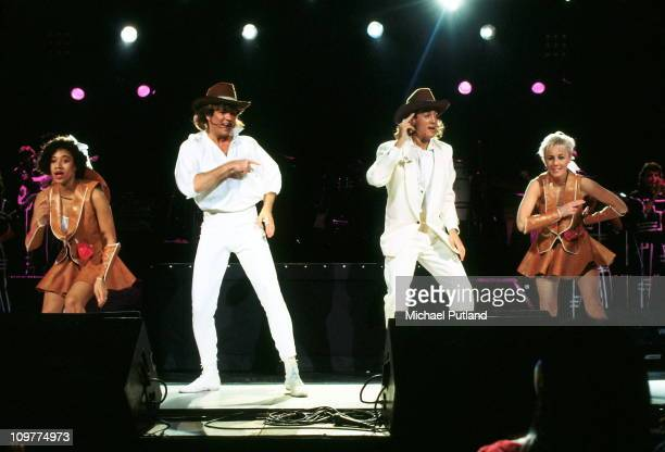 Helen 'Pepsi' Demacque George Michael Andrew Ridgeley and Shirlie Holliman of Wham performing on stage in 1985