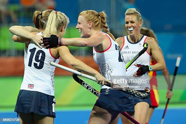 Helen RichardsonWalsh Sophie Bray and Nicola White of Great Britain celebrate after RichardsonWalsh scored a first half goal against Spain during the...