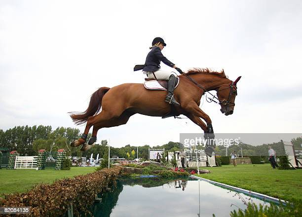 Helen Tredwell riding Opportunity B jumps the Water Jump during the Old Lodge Queen Elizabeth II Cup on July 26 in Hickstead England