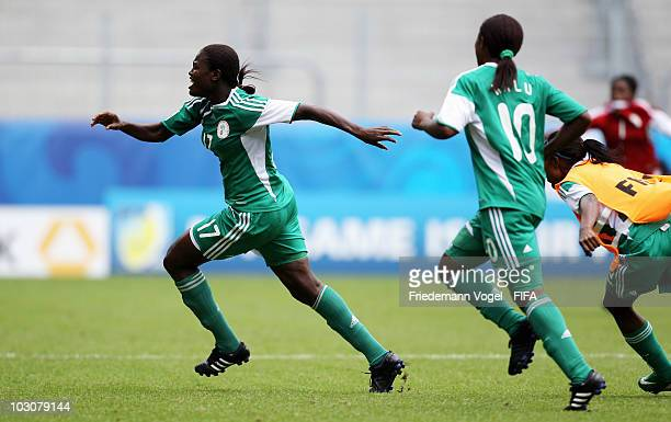 Helen Ukaonu of Nigeria celebrates after scoring her team 's first goal during the FIFA U20 Women's World Cup Quarter Final match between USA and...