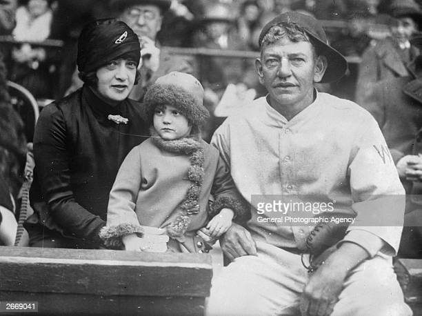 Helen Woodford Ruth the wife of baseball legend Babe Ruth holds his child Dorothy Ruth and sits next to baseball player Nick Affrock