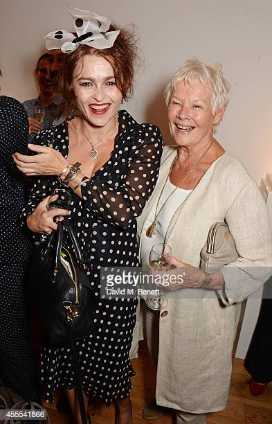 Helena Bonham Carter and Judi Dench attend a private view for Nicole Farhi's debut exhibition of sculptures 'From The Neck Up' at Bowman Sculpture on...
