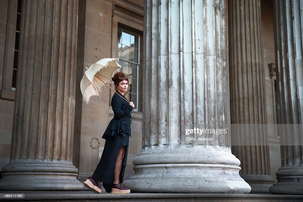 Helena Bonham Carter holds her original parasol from 'A Room With a View' as she attends a photocall to launch BFI Love at The British Museum on August 27, 2015 in London, England.