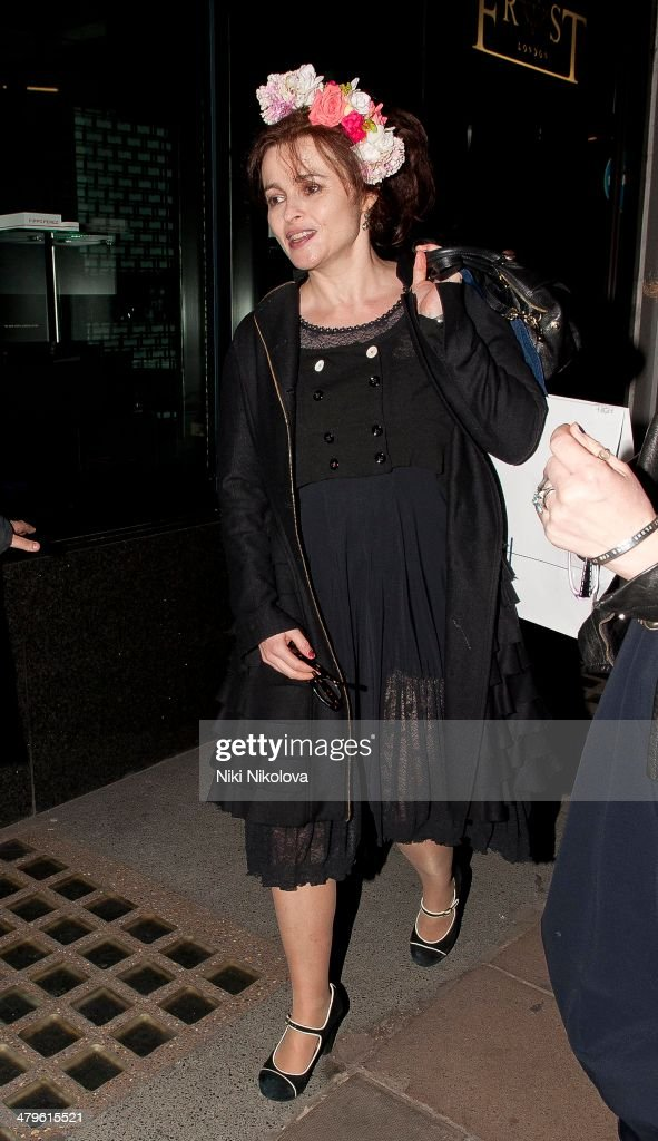 <a gi-track='captionPersonalityLinkClicked' href=/galleries/search?phrase=Helena+Bonham+Carter&family=editorial&specificpeople=210567 ng-click='$event.stopPropagation()'>Helena Bonham Carter</a> is seen leaving HIGH flagship store, Mayfair on March 19, 2014 in London, England.