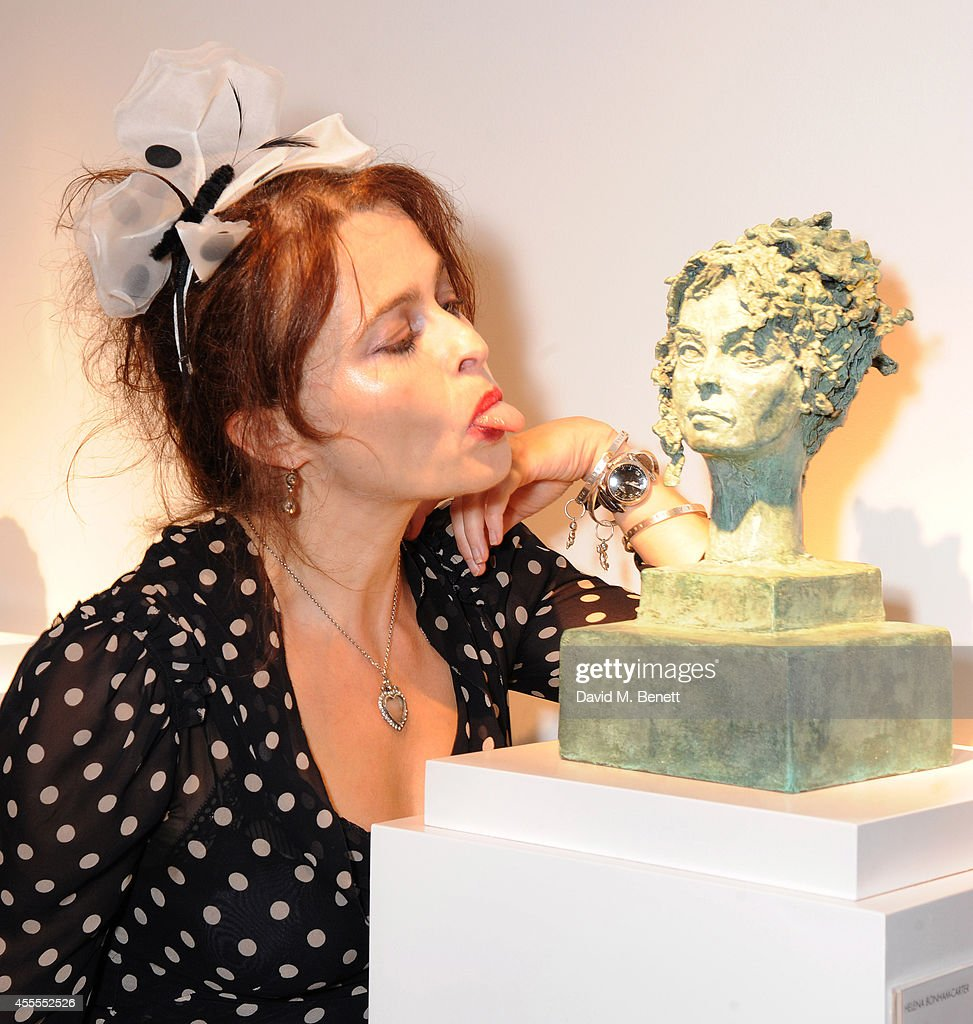 Helena BonhamCarter attends the private view for Nicole Farhi's debut exhibition of sculptures 'From The Neck Up' on September 16 2014 in London...