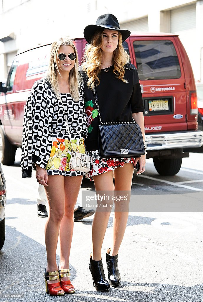Helena Bordon(L) is seen outside the Ralph Lauren show wearing a Isolda outfit, Prada shoes and a Fendi bag with Chiara Ferragni(R) who is wearing a MSGM skirt, Chiarra Ferragni shoes and a Chanel bag on September 12, 2013 in New York City.