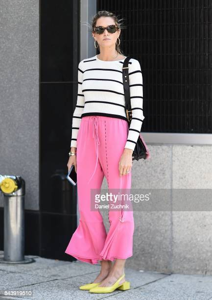 Helena Bordon is seen wearing a black and white striped top pink 31 Phillip Lim pants and a Prada bag outside the Brock Collection during New York...