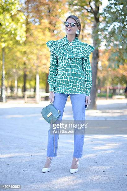 Helena Bordon poses after the Margiela show at the Jardin des Tuileries during Paris Fashion Week SS16 on September 30 2015 in Paris France