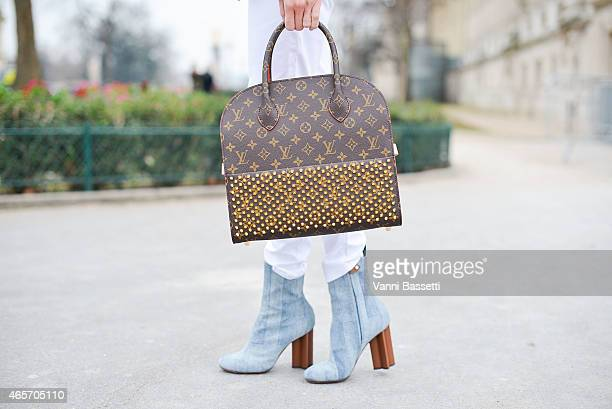 Helena Bordon poses wearing Louis Vuitton shoes and bag on Day 7 of Paris Fashion Week Womenswear FW15 on March 9 2015 in Paris France