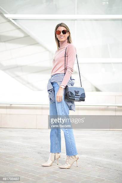 Helena Bordon poses with a Louis Vuitton bag before the Louis Vuitton show at the Fondation Louis Vuitton during Paris Fashion Week SS16 on October 7...