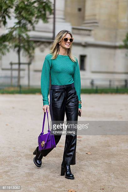 Helena Bordon wearing a green sweater black leather pants and purple Gucci bag outside Mugler on October 1 2016 in Paris France