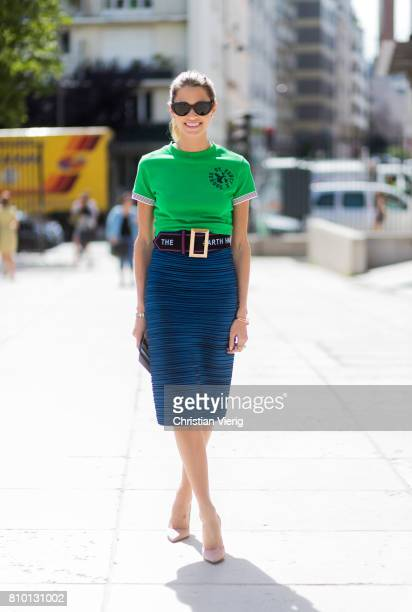 Helena Bordon wearing a green top navy pencil skirt belt outside Viktor Rolf during Paris Fashion Week Haute Couture Fall/Winter 20172018 Day Four on...
