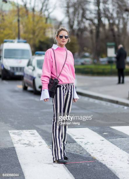 Helena Bordon wearing a striped white pant pink sweater outside Chanel on March 7 2017 in Paris France