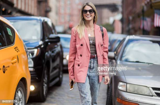 Helena Bordon wearing salmon coloured blazer jacket Gucci belt bag seen in the streets of Manhattan outside Tibi during New York Fashion Week on...