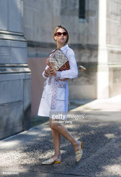 Helena Bordon wearing white dress clutch slippers seen in the streets of Manhattan outside Tory Burch during New York Fashion Week on September 8...