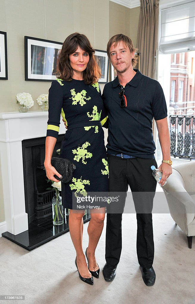 <a gi-track='captionPersonalityLinkClicked' href=/galleries/search?phrase=Helena+Christensen&family=editorial&specificpeople=202841 ng-click='$event.stopPropagation()'>Helena Christensen</a> and <a gi-track='captionPersonalityLinkClicked' href=/galleries/search?phrase=Paul+Banks+-+Musician&family=editorial&specificpeople=227391 ng-click='$event.stopPropagation()'>Paul Banks</a> attend MATCHESFASHION.COM Partners With Rika On 'Iron Girl' Project For Rika Magazine on July 18, 2013 in London, England.