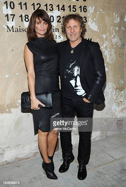 Helena Christensen and Renzo Rosso attend the Maison Martin Margiela with HM global launch event at 5 Beekman on October 23 2012 in New York City