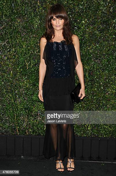 Helena Christensen attends the Chanel and Charles Finch preOscar dinner at Madeo Restaurant on March 1 2014 in Los Angeles California