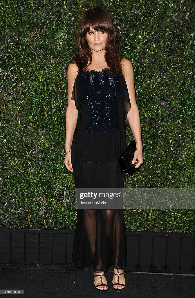 <a gi-track='captionPersonalityLinkClicked' href=/galleries/search?phrase=Helena+Christensen&family=editorial&specificpeople=202841 ng-click='$event.stopPropagation()'>Helena Christensen</a> attends the Chanel and Charles Finch pre-Oscar dinner at Madeo Restaurant on March 1, 2014 in Los Angeles, California.
