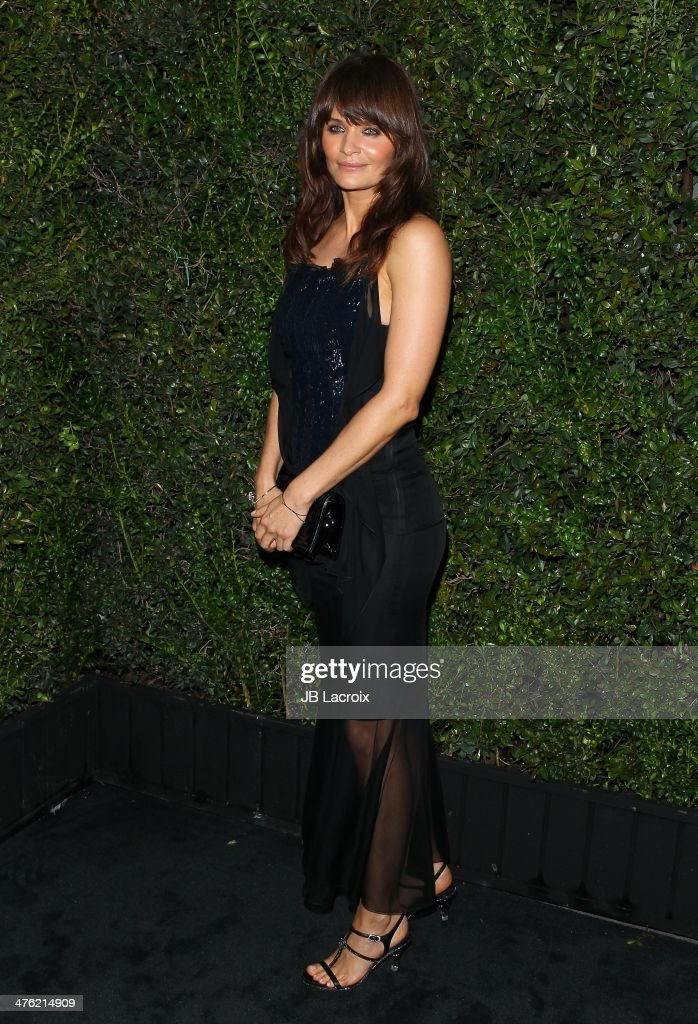 <a gi-track='captionPersonalityLinkClicked' href=/galleries/search?phrase=Helena+Christensen&family=editorial&specificpeople=202841 ng-click='$event.stopPropagation()'>Helena Christensen</a> attends the Chanel Charles Finch Pre-Oscar Dinner held at Madeo Restaurant on March 1, 2014 in Los Angeles, California.