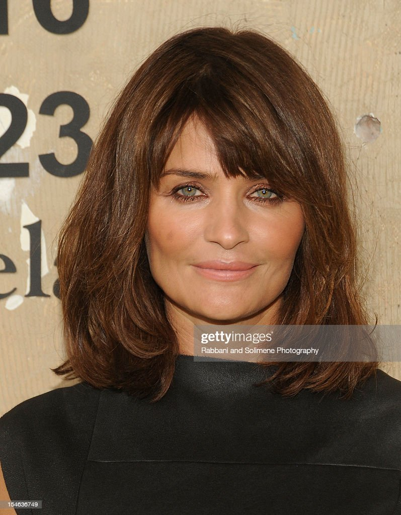 Helena Christensen attends the Maison Martin Margiela with H&M global launch event at 5 Beekman on October 23, 2012 in New York City.