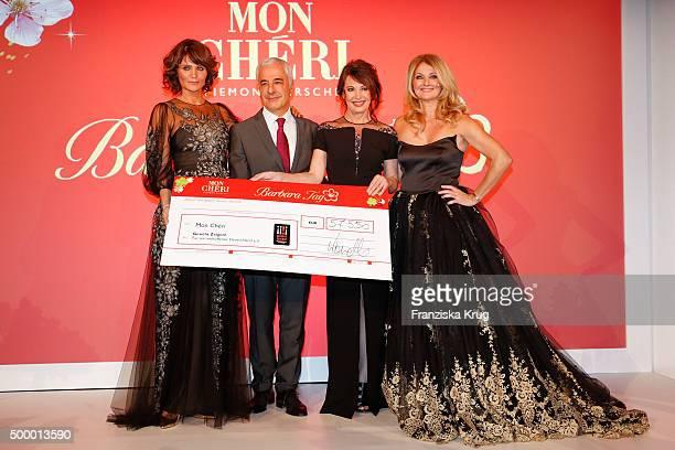 Helena Christensen director of Ferrero Germany Carlo Vassallo Iris Berben and Frauke Ludowig attend the Mon Cheri Barbara Tag 2015 at Postpalast on...