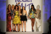Helena Christensen Georgina Chapman Naomi Campbell and Daphne Guinness pose with models wearing Alexander McQueen designs on the runway at Naomi...
