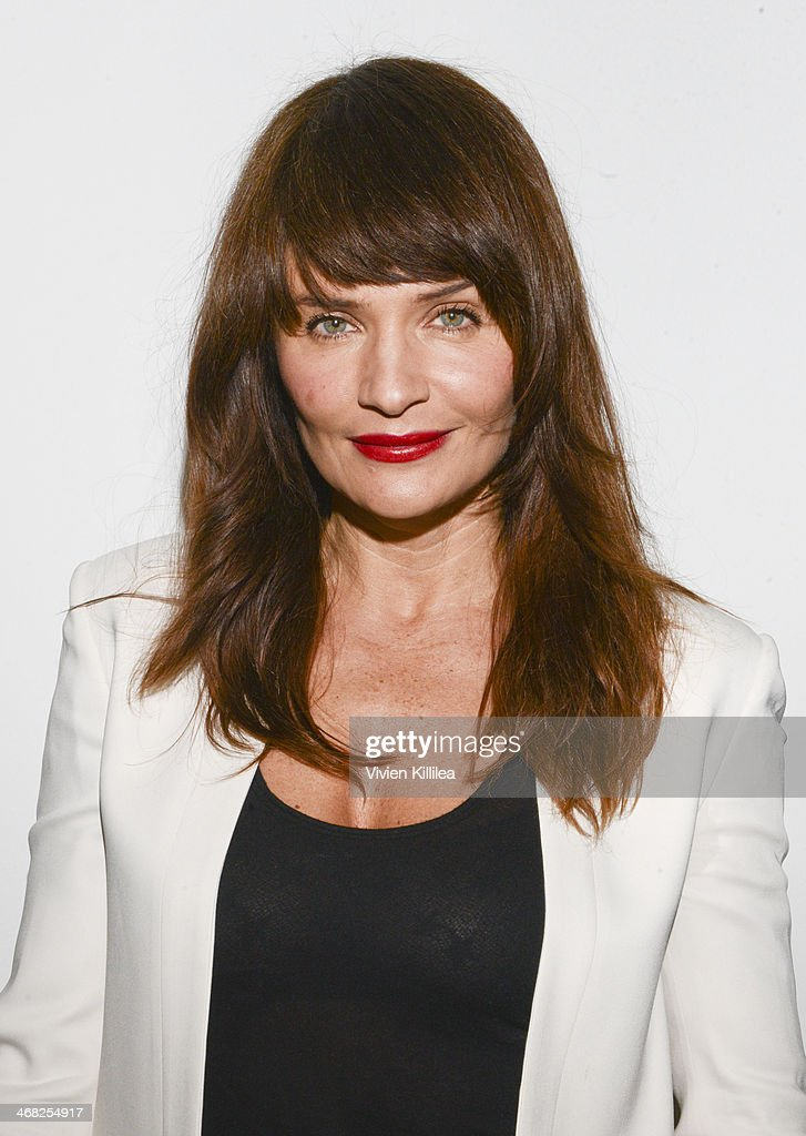 Helena Christensen poses backstage at the Edun show during Mercedes-Benz Fashion Week Fall 2014 at Skylight Modern on February 9, 2014 in New York City.