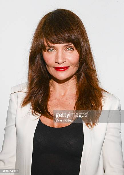 Helena Christensen poses backstage at the Edun show during MercedesBenz Fashion Week Fall 2014 at Skylight Modern on February 9 2014 in New York City