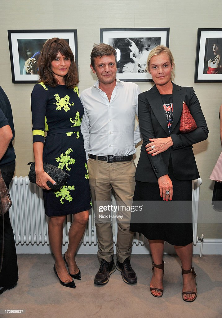 <a gi-track='captionPersonalityLinkClicked' href=/galleries/search?phrase=Helena+Christensen&family=editorial&specificpeople=202841 ng-click='$event.stopPropagation()'>Helena Christensen</a>, Tom Chapman and Ulrika Lindgren attend MATCHESFASHION.COM Partners With Rika On 'Iron Girl' Project For Rika Magazine on July 18, 2013 in London, England.