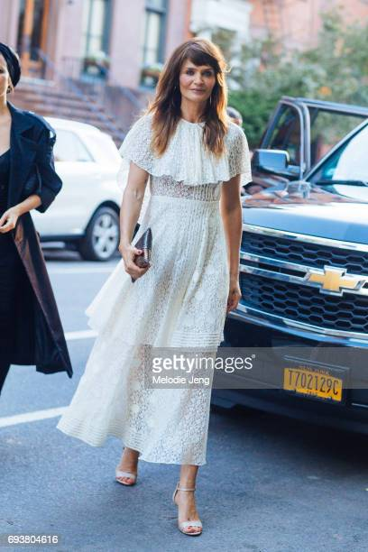 Helena Christensen wears a white lace dress outside the Stella McCartney Spring 18 presentation on June 8 2017 in New York City