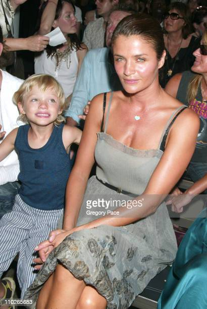 Helena Christensen with son Mingus during Olympus Fashion Week Spring 2006 Calvin Klein Backstage and Front Row at Milk Studios in New York City New...